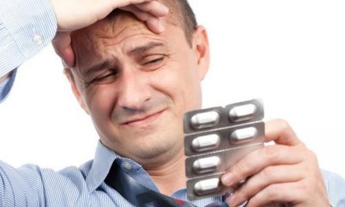 Прием таблетки от головной боли